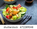fried tofu salad with cucumbers ... | Shutterstock . vector #672289048