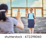 parent and pupil of primary... | Shutterstock . vector #672298060