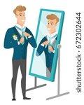 cheerful caucasian groom has a... | Shutterstock .eps vector #672302644