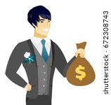 asian groom showing a money bag ... | Shutterstock .eps vector #672308743