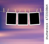 retro photo frames hung on a... | Shutterstock .eps vector #672310864