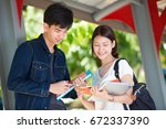 young asian students talk...   Shutterstock . vector #672337390