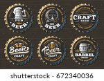 Stock vector set beer logo on caps vector illustration emblem brewery design on black background 672340036