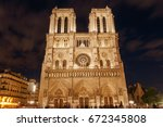 view on front side of notre... | Shutterstock . vector #672345808