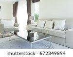 minimal white modern living room | Shutterstock . vector #672349894