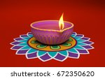 indian traditional oil lamp... | Shutterstock . vector #672350620