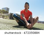 disabled man athlete stretching ... | Shutterstock . vector #672350884