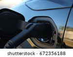 black electric car plug at home.... | Shutterstock . vector #672356188