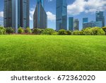 buildings and green lawn | Shutterstock . vector #672362020