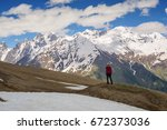 man traveler stands on the... | Shutterstock . vector #672373036