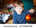 Cute Little Kid Boy Decorating...