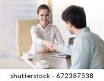 cheerful businesswoman... | Shutterstock . vector #672387538
