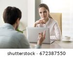 two business partners... | Shutterstock . vector #672387550