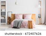 wooden decor spacious bedroom...   Shutterstock . vector #672407626