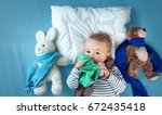 ill boy lying in bed. sad child ... | Shutterstock . vector #672435418