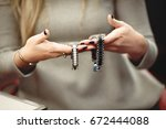 woman looking at two watches | Shutterstock . vector #672444088