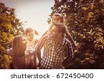 happy family in nature. parents ... | Shutterstock . vector #672450400