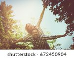 boyfriend carries the girl on... | Shutterstock . vector #672450904