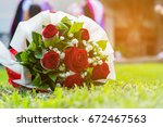 wedding bonquet of red rose on... | Shutterstock . vector #672467563