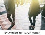 people walking in the street  ... | Shutterstock . vector #672470884