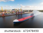 dry cargo ship in the port of... | Shutterstock . vector #672478450
