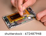 modern cellphone assembly with... | Shutterstock . vector #672487948