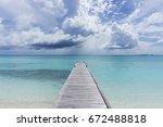 Wooden Pier Over Tropical Clea...