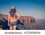girl using hat at an african... | Shutterstock . vector #672505654