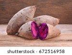 purple sweet potatoes on a... | Shutterstock . vector #672516958