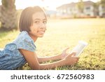 asian girl is using a tablet in ... | Shutterstock . vector #672560983