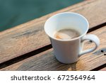 A Cup Of Coffee On Wooden Tabl...