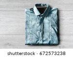 folded blue elegant shirt on...   Shutterstock . vector #672573238