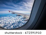 plane window view with blue sky ... | Shutterstock . vector #672591910