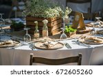 wedding dining table setting. | Shutterstock . vector #672605260