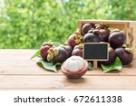 fresh mangosteen fruits and... | Shutterstock . vector #672611338
