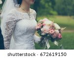bride with flowers  bride... | Shutterstock . vector #672619150