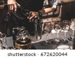 bartender making alcoholic... | Shutterstock . vector #672620044