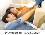 young lovely couple lying in... | Shutterstock . vector #672626524