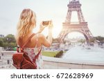 tourist in paris visiting... | Shutterstock . vector #672628969