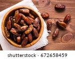 sweet dried dates fruit in a... | Shutterstock . vector #672658459