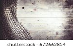 fishing nets on wooden... | Shutterstock . vector #672662854