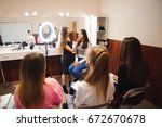 professional makeup teacher... | Shutterstock . vector #672670678