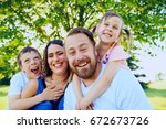 portrait of happy parents... | Shutterstock . vector #672673726