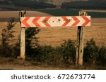 Small photo of South African road sign arrows pointing in both directions. T-intersection sign. Rural background. Can be used as symbol of coming to a decision junction point.