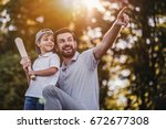 handsome dad with his little... | Shutterstock . vector #672677308