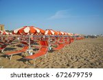 orange umbrellas and chaise... | Shutterstock . vector #672679759