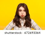 young brunette in shirt looking ... | Shutterstock . vector #672693364
