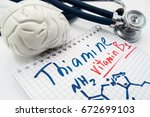 Small photo of Vitamin B1 Thiamin concept photo. Stethoscope and brain figure lies next to inscription Vitamin B1 thiamin and vitamin chemical formula. Idea for visualization of deficiency or hypervitaminosis