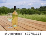 a bottle of white wine with a... | Shutterstock . vector #672701116