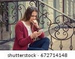 anxious woman watching media in ... | Shutterstock . vector #672714148